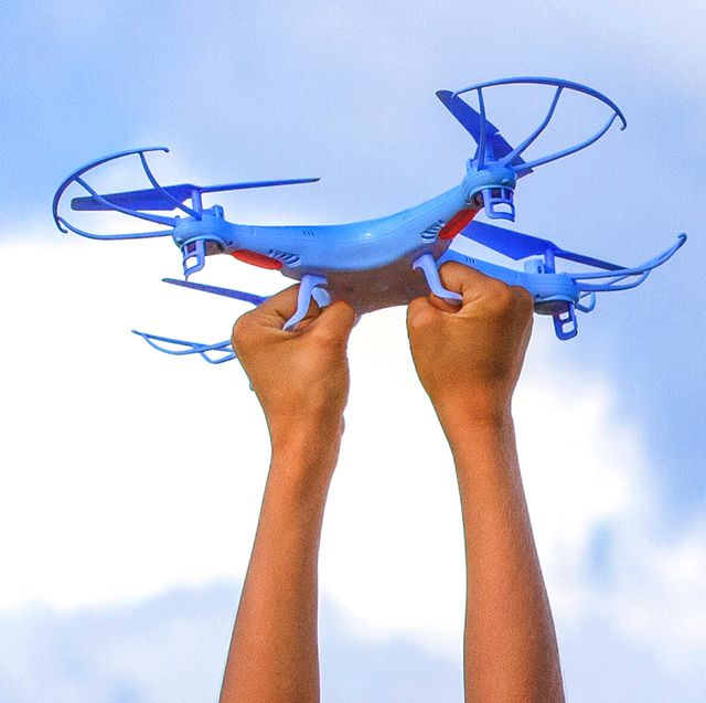 kid's hands holding drone toy