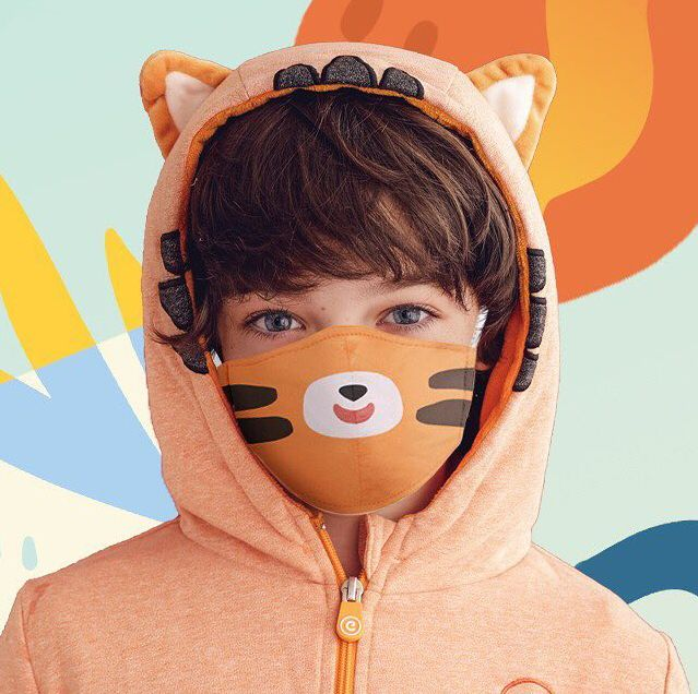 boy wearing tiger face mask and hoodie