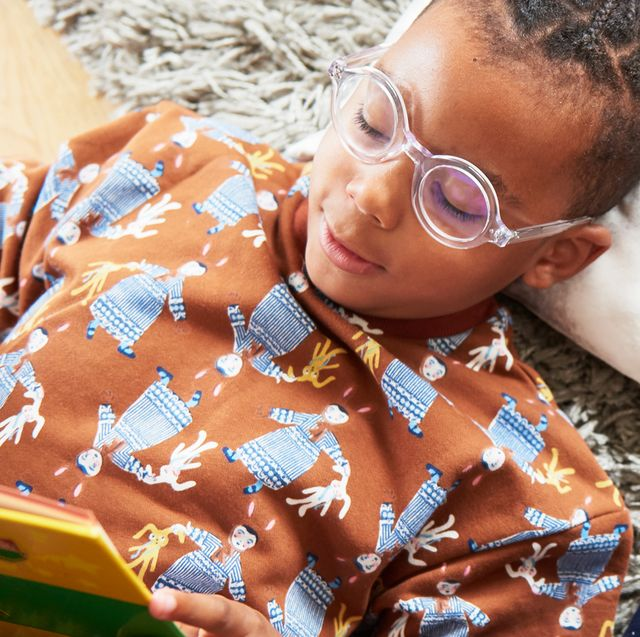 boy in glasses reading with friend