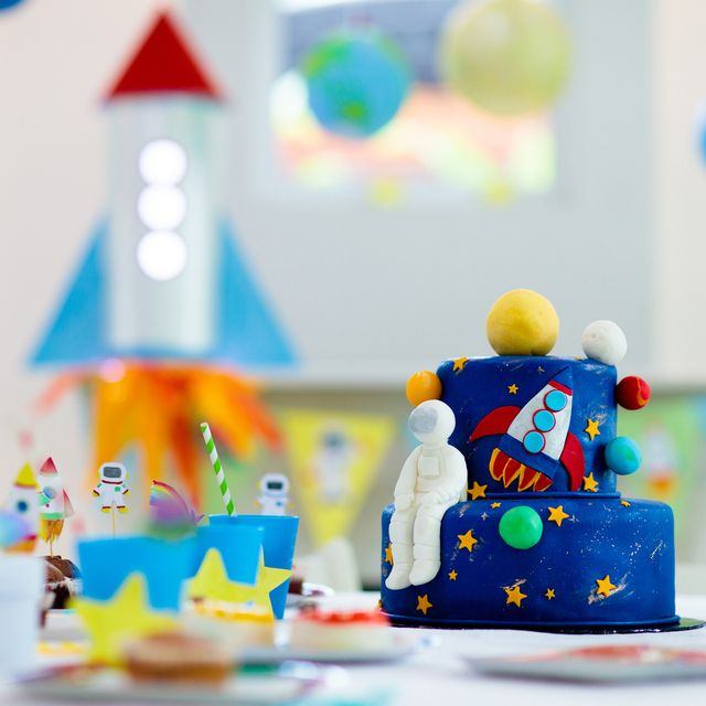 kids space theme birthday party with cake