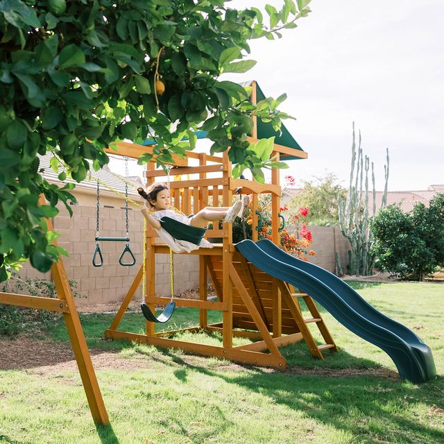 kid swinging on swing set