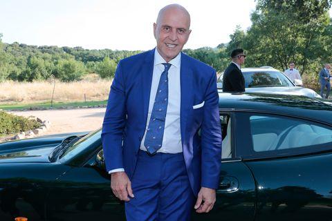 Land vehicle, Vehicle, Car, Luxury vehicle, Electric blue, Automotive design, Outerwear, Suit, Mid-size car, Performance car,