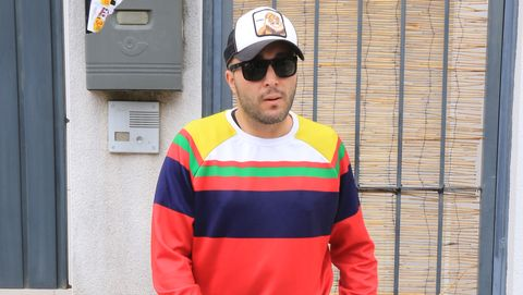 Street fashion, Clothing, Red, Yellow, Jeans, Standing, Jacket, Workwear, Fashion, High-visibility clothing,
