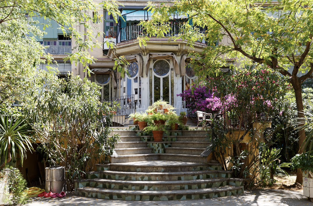outside of killing eve apartment with stairs and trees