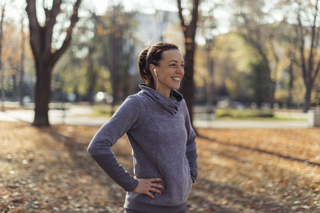 girl catching breath after morning run