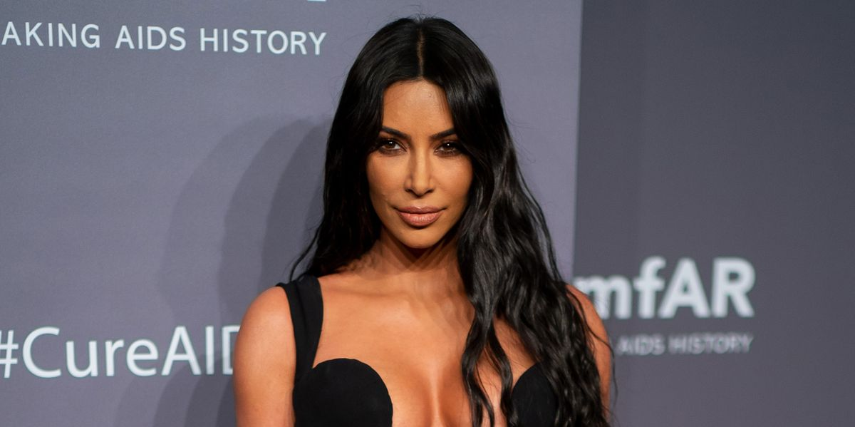 f440327fda8 Kim Kardashian Wears the Sexiest Vintage Versace Dress to the amFAR Gala