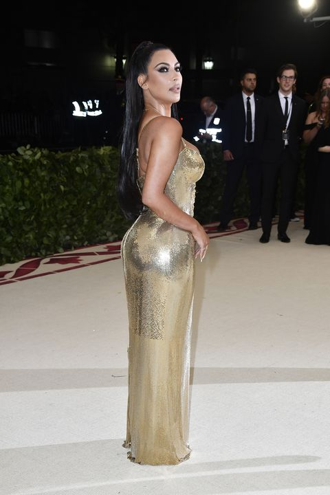 Kim Kardashian Wears Gold Versace Dress to Met Gala 2018