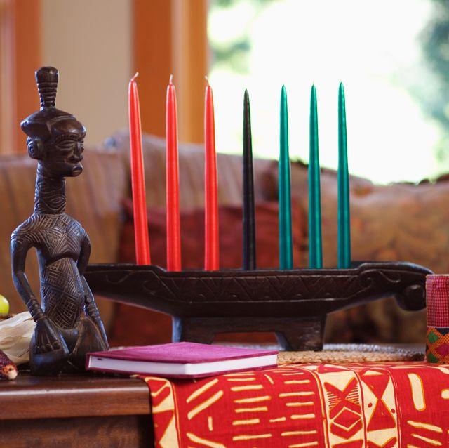 kinara with kwanzaa candles on coffee table