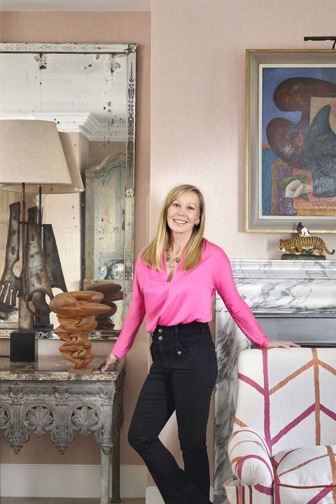 interior designer kit kemp next to her treasured object, a sculpture by tony cragg photography by simon brown