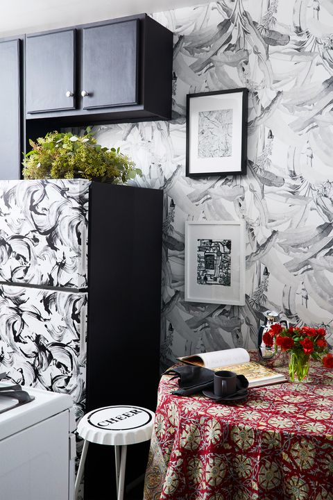 small black and white wallpapered kitchen