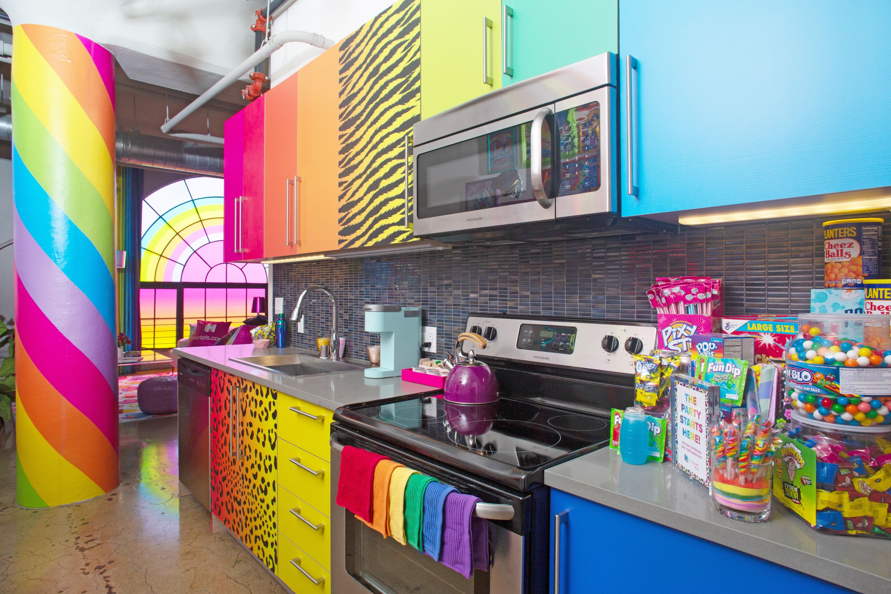 This Lisa Frank Flat Is Stocked With All Your Favorite '90s Snacks—And You Can Stay The Night