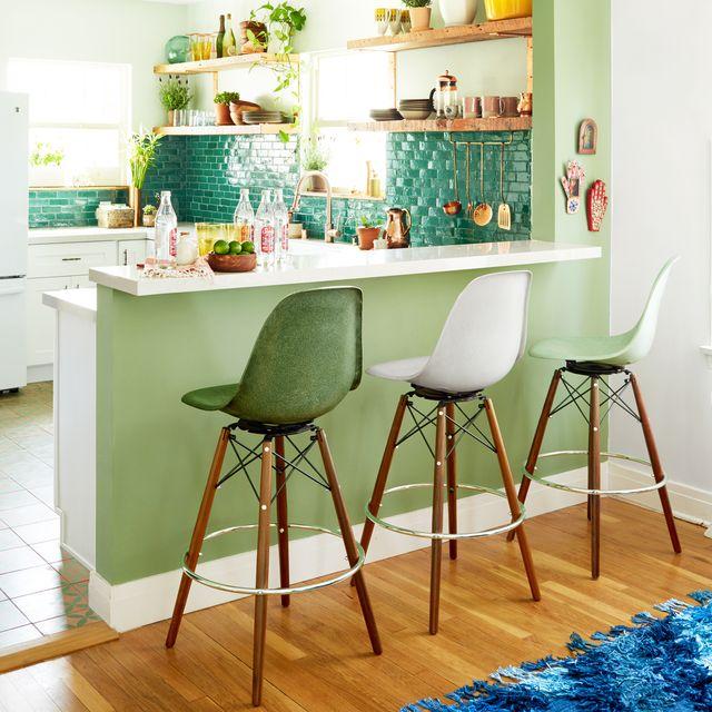 green kitchen with tile backsplash