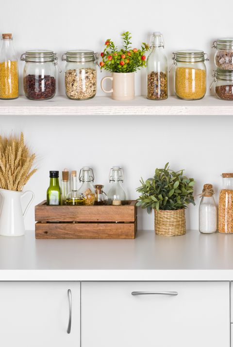 Kitchen bench shelves with various food ingredients - herbs and spices