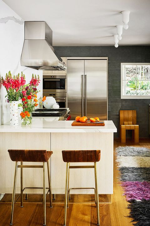 small modern kitchen with colorful runner