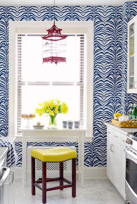 gallery kitchen with yellow stool