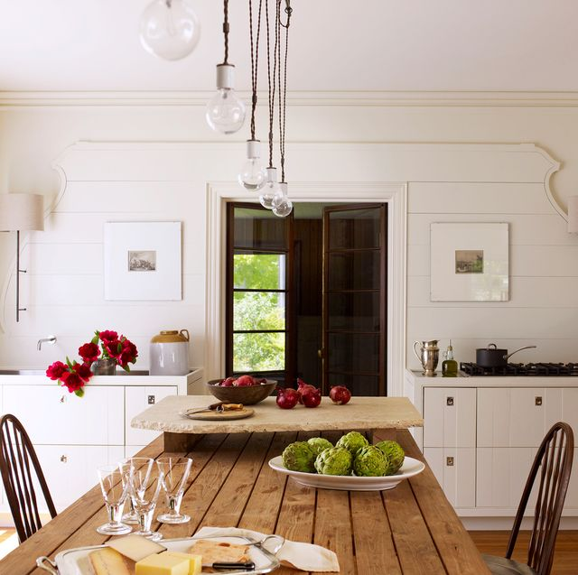 contemporary white kitchen with table instead of island