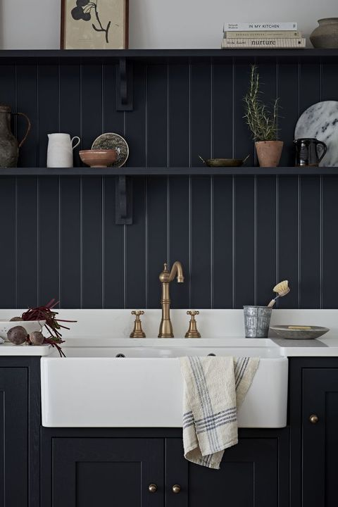 navy kitchen with small shelf above