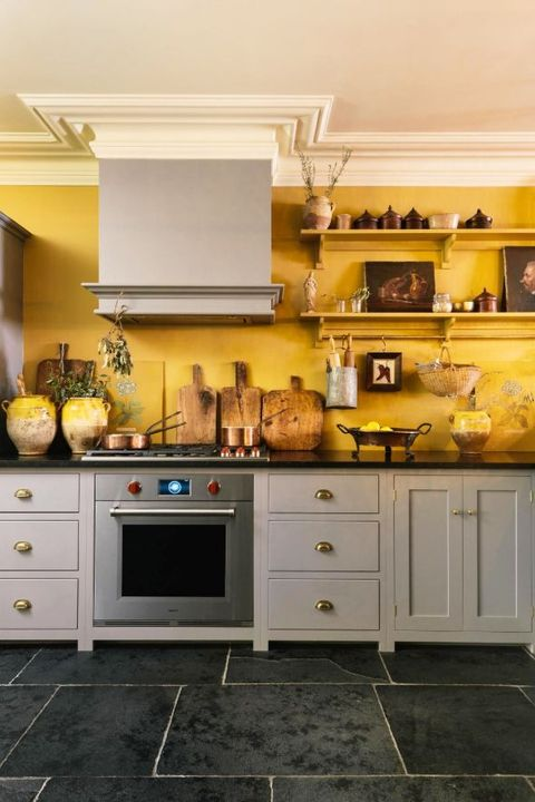 Countertop, Cabinetry, Kitchen, Room, Furniture, Property, Yellow, Tile, Floor, Interior design,