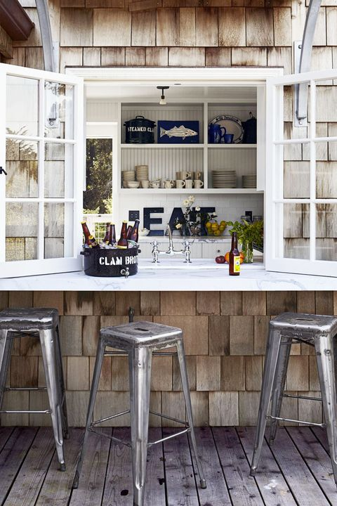 Indoor outdoor kitchen with metal stools