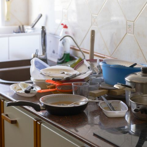 kitchen piled over with dirty dishes
