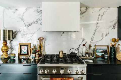 kitchen counter with green cabinets