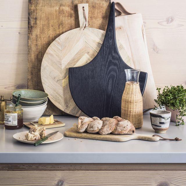 preparing food on kitchen worktop, cutting boards, herbs