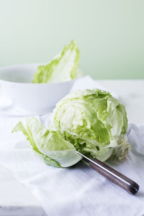 Knife slicing through head of lettuce