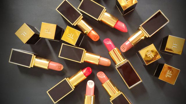 Amber, Lipstick, Tan, Gold, Brass, Material property, Cosmetics, Ammunition, Personal care, Still life photography,