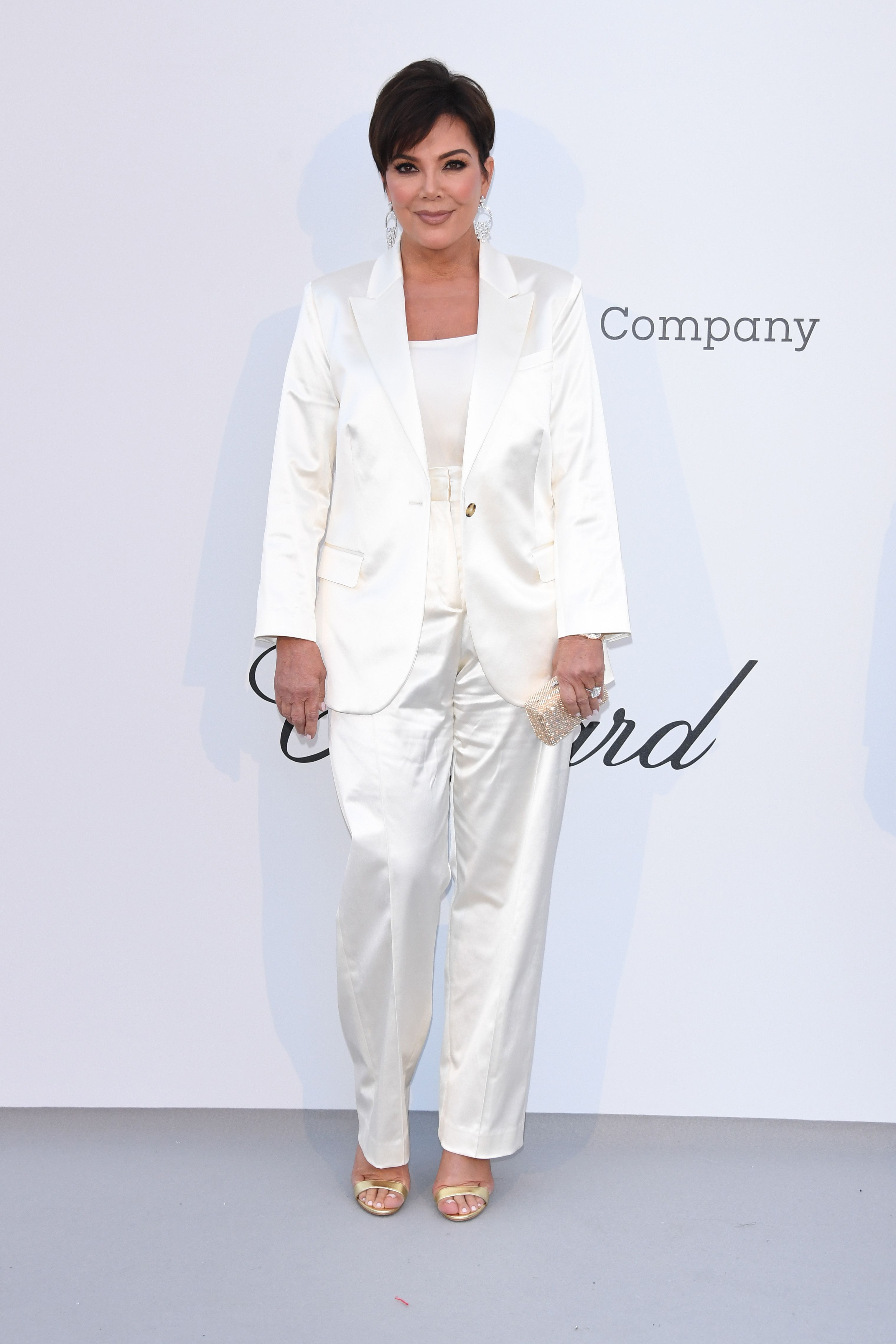 Kris Jenner In a white silk suit.