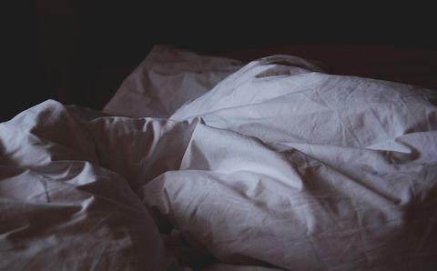 Bed sheet, Textile, Room, Linens, Hand, Furniture, Bedding, Darkness, Bed,