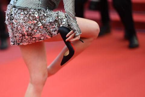 Red, Human leg, Leg, Footwear, Fashion, High heels, Red carpet, Thigh, Joint, Carpet,