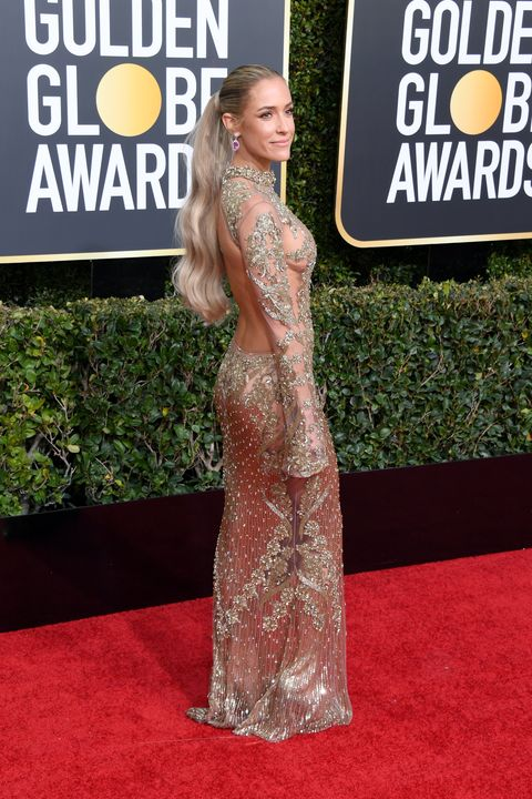 Red carpet, Carpet, Clothing, Dress, Flooring, Hairstyle, Premiere, Fashion, Long hair, Gown,
