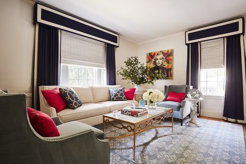 living room, beige couch, red cushions
