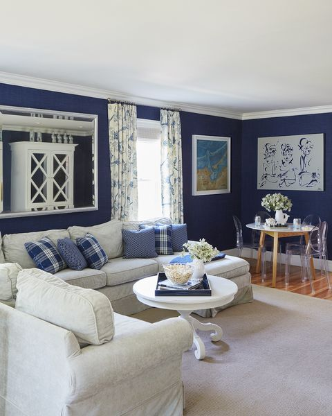 blue wallpaper, white couch, ghost chairs, white coffeetable