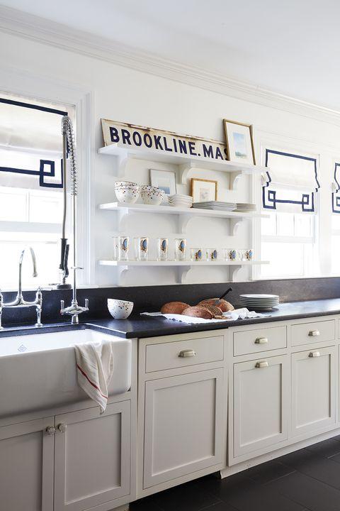 white kitchen, black countertops
