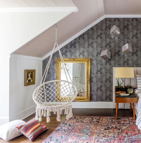 bedroom with hanging chair