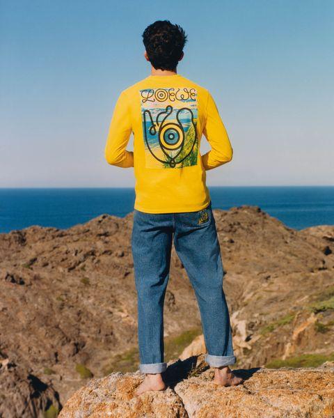 Blue, Yellow, T-shirt, Sea, Azure, Outerwear, Coast, Vacation, Fun, Top,