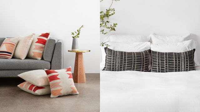 red, pink and orange pillows on a couch and a bed with white bedding and black pattern pillows