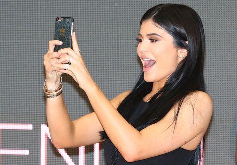 Hair, Beauty, Black hair, Arm, Long hair, Photography, Muscle, Selfie, Electronic device, Brown hair,