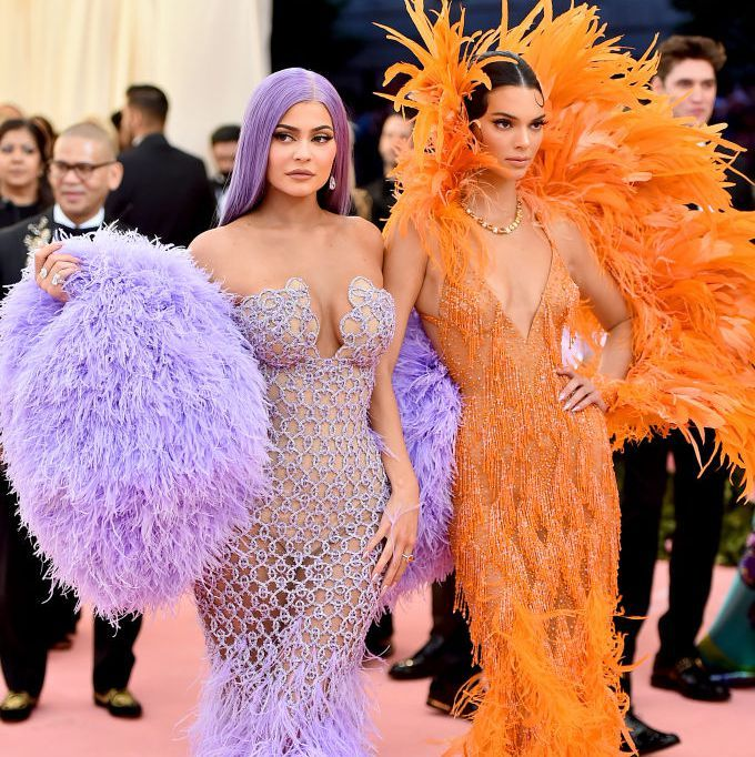 4dda12e82f78 Kendall and Kylie Jenner Totally Crushed the Met Gala Red Carpet Wearing a  Billion Feathers