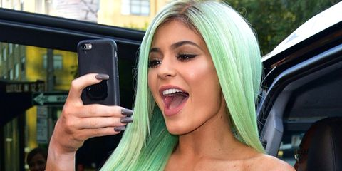 Hair, Blond, Eyebrow, Lip, Black hair, Mouth, Technology, Long hair, Electronic device, Hair coloring,