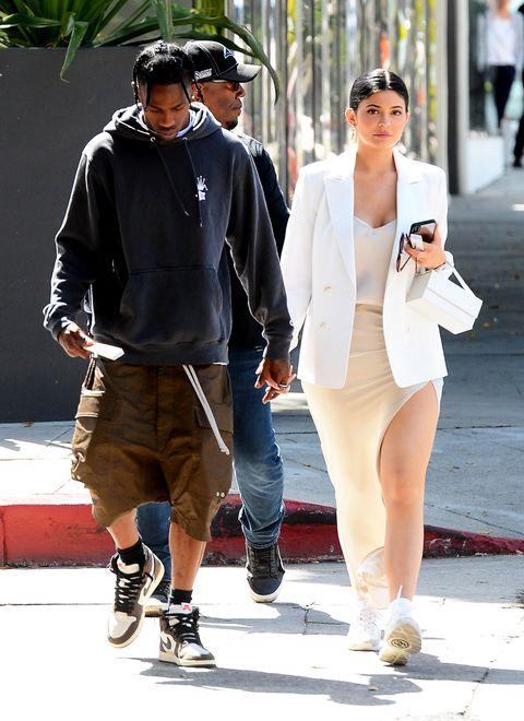White, Street fashion, Walking, Fashion, Snapshot, Sunglasses, Eyewear, Footwear, Leg, Shoulder,