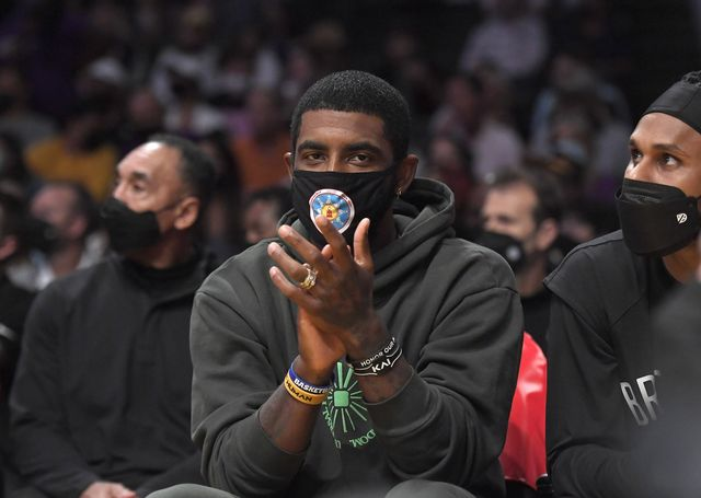 los angeles, ca   october 03 kyrie irving 11 of the brooklyn nets cheers from the bench during a preseason game against the los angeles lakers at staples center on october 3, 2021 in los angeles, california note to user user expressly acknowledges and agrees that, by downloading andor using this photograph, user is consenting to the terms and conditions of the getty images license agreement photo by kevork djanseziangetty images