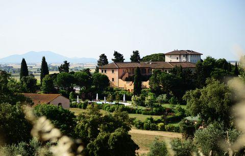 Natural landscape, Sky, Tree, Estate, Rural area, House, Village, Hill station, Building, Hill,