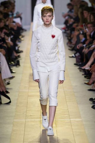 Clothing, Footwear, Leg, Fashion show, Event, Shoulder, Joint, Runway, Outerwear, White,