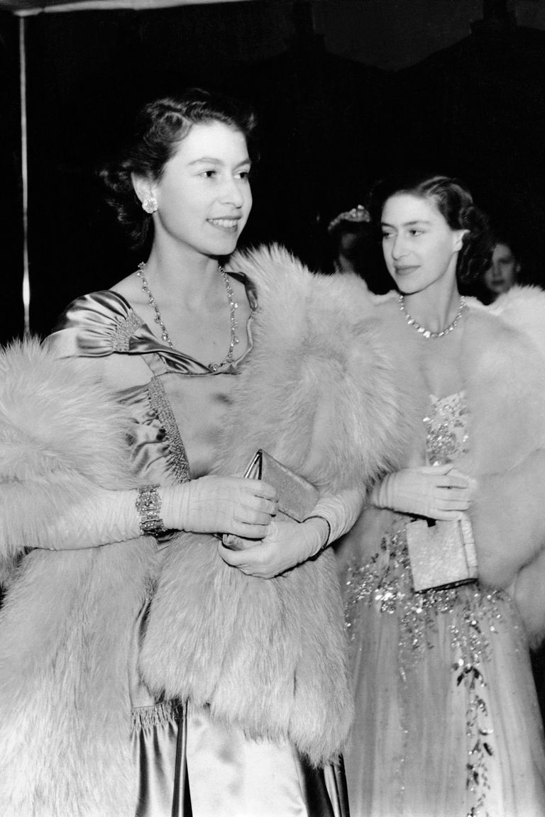 Then-Princess Elizabeth and Princess Margaret went glamorous for a royal variety performance in London. The sisters each wore an elaborate ball gown with fur wraps.