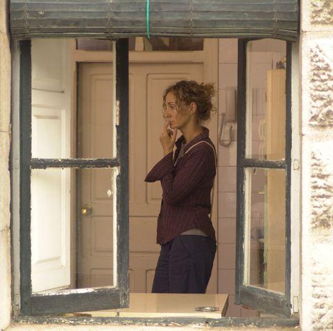 Standing, Wall, Fixture, Home door, Khaki, Beige, Door,