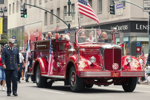 labor day parade in manhattan with red fire truck
