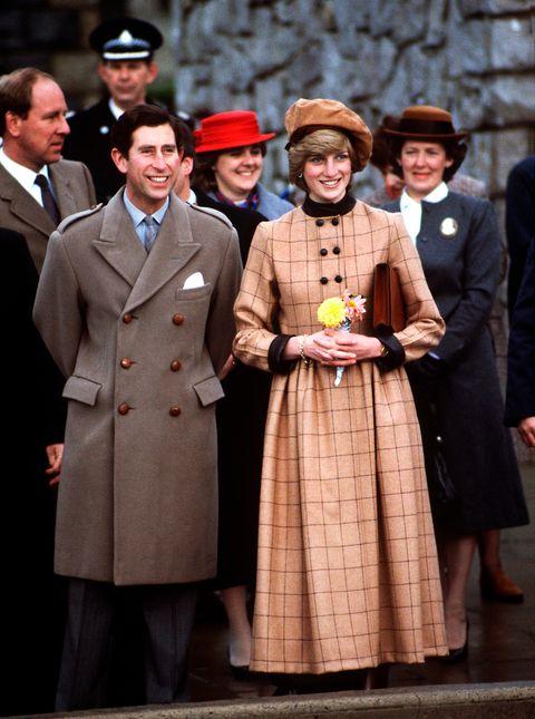 lady di with plaid coat