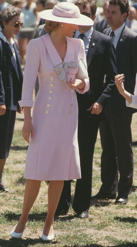 lady di in dusty pink midi dress and hat